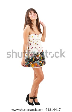 Full length portrait of a sexy young girl standing over white background