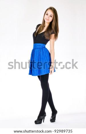 Full length portrait of a slender brunette young model.