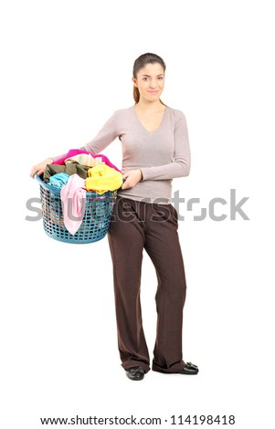 Full length portrait of a smiling female holding a laundry basket isolated on white background