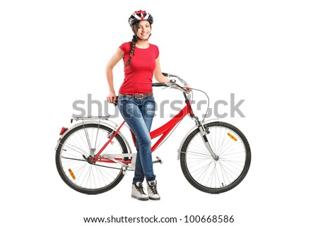 Full length portrait of a smiling female posing next to a bicycle isolated on white background