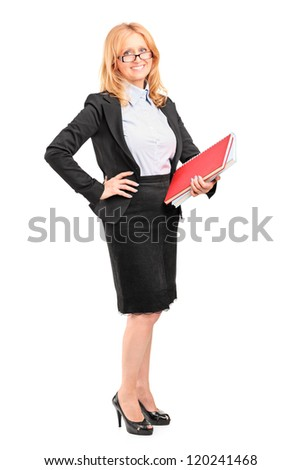 Full length portrait of a smiling female teacher holding a notebook isolated on white background