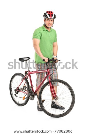 Full length portrait of a smiling man posing with a mountain bike isolated on white background