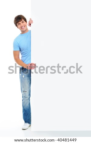 Full-length portrait of a smiling young handsome man with blank banner