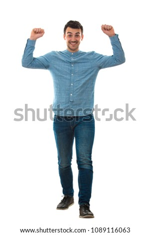 Full length portrait of a smiling young man with hands raised up holding imaginary weights isolated on white background.