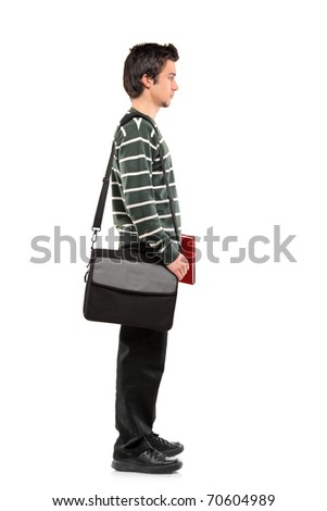 Full length portrait of a student with a school bag on his shoulder standing in line isolated on white background - stock photo
