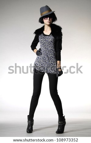 Full length portrait of a styled professional model. Theme: beauty, fashion