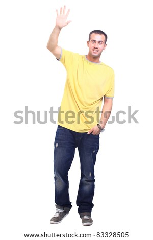 Full length portrait of a stylish young man standing with hands in pockets over white background