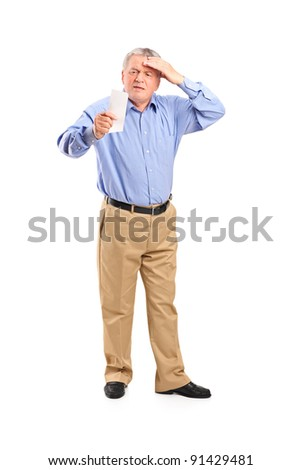 Full length portrait of a surprised senior looking at store receipt isolated on white background