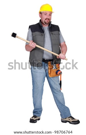 Full-length portrait of a tradesman holding a mallet