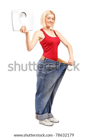 Full length portrait of a weight loss female holding a weight scale isolated on white background - stock photo