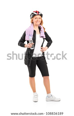 Full length portrait of a woman holding a bottle of water after exercise isolated on white background