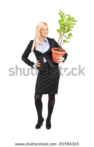 Full length portrait of a woman holding a pot with decoration plant isolated on white background