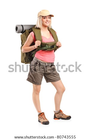 Full length portrait of a woman in sportswear with backpack posing isolated on white background