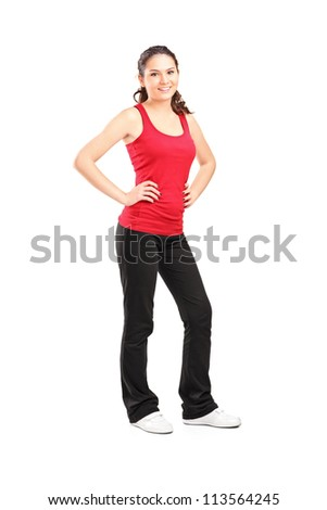 Full length portrait of a young athletic girl posing isolated on white background