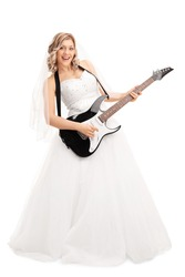 Full length portrait of a young blond bride playing electric guitar isolated on white background