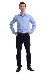 full length portrait of a young businessman standing with his hands on hips. Isolated on white background