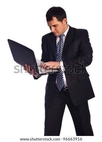 Full length portrait of a young businessman standing with laptop