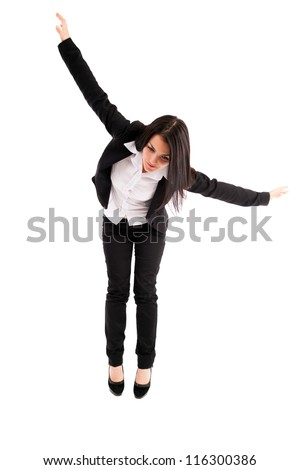 Full length portrait of a young businesswoman falling down