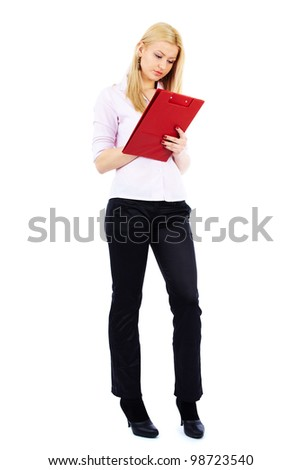 Full length portrait of a young businesswoman writing on a clipboard - stock photo