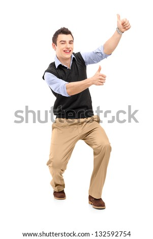 Full length portrait of a young cheerful man gesturing happiness with thumbs up isolated on white background