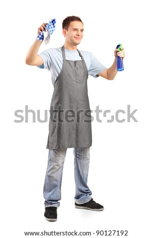 Full length portrait of a young cleaner holding a cleaning supplies isolated on white background