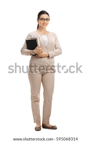 Full length portrait of a young female teacher looking at the camera and smiling isolated on white background