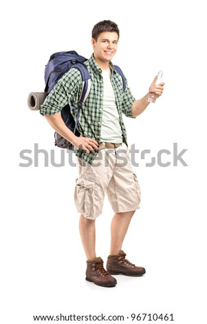 Full length portrait of a young hiker holding a bottle of water isolated on white background