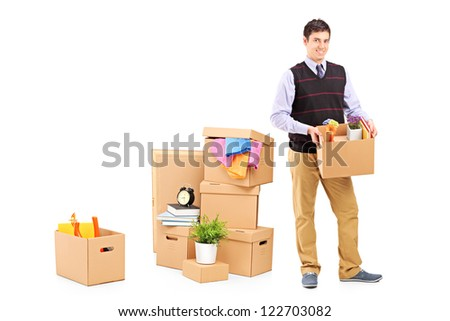 Full length portrait of a young male and moving boxes isolated on white background
