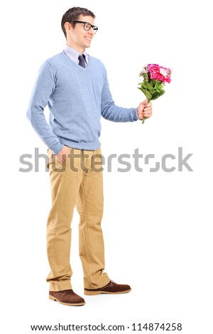 Full length portrait of a young man holding flowers isolated on white background