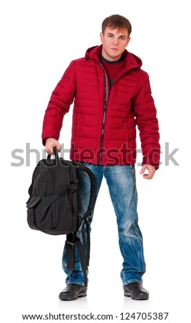 Full length portrait of a young man in winter clothing with backpack isolated on white background