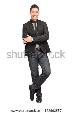 Full length portrait of a young man smiling and leaning on a virtual wall isolated on white background