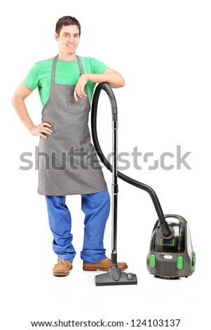 Full length portrait of a young man with a vacuum cleaner isolated on white background