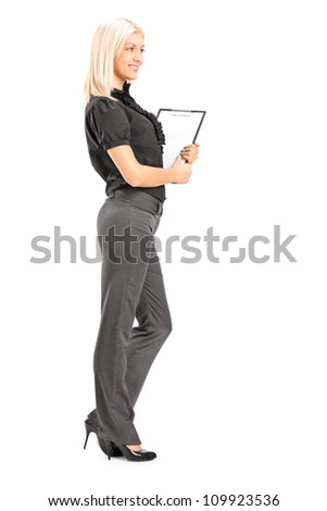 Full length portrait of a young professional woman holding a clipboard, isolated on white background