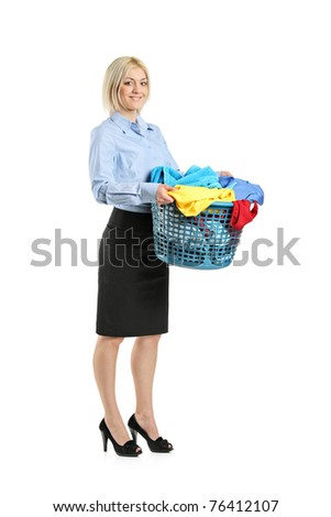 Full length portrait of a young smiling woman holding a laundry basket isolated on white background