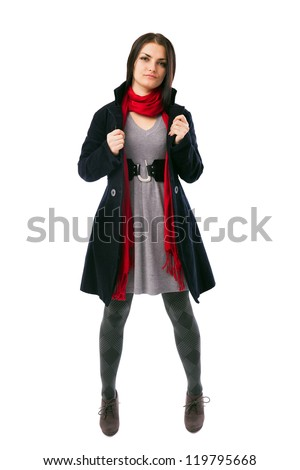 Full length portrait of a young woman wearing coat isolated on white background