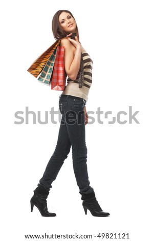 Full length portrait of a young woman with bags over white