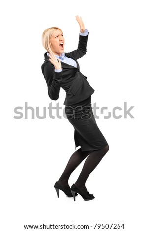 Full length portrait of an afraid young businesswoman isolated on white background