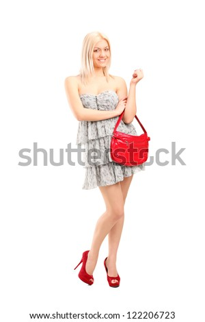 Full length portrait of an attractive sexy blond female holding a purse bag isolated on white background