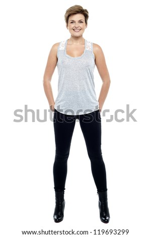 Full length portrait of an attractive woman in tights and ankle boots