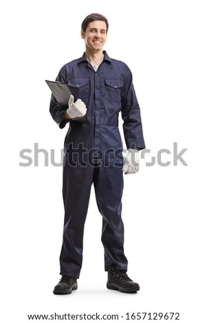 Full length portrait of an auto mechanic holding a clipboard isolated on white background Photo stock ©