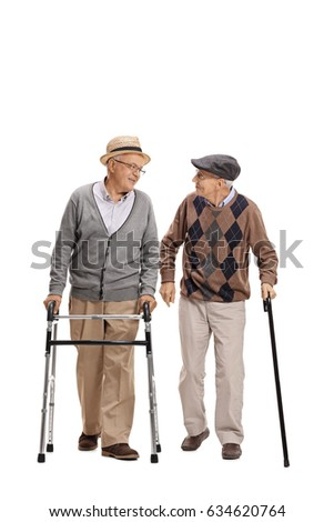 Full length portrait of an elderly man with a walker and another man with a cane walking towards the camera isolated on white background #634620764