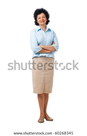 Full length portrait of an elderly woman standing with folded hands.