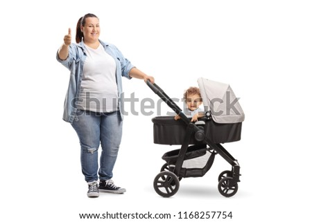 Full length portrait of an overweight mother with a stroller and baby showing thumbs up isolated on white background