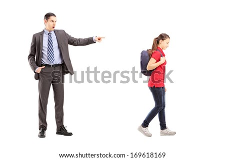 Full length portrait of angry father yelling at his daughter, isolated on white background