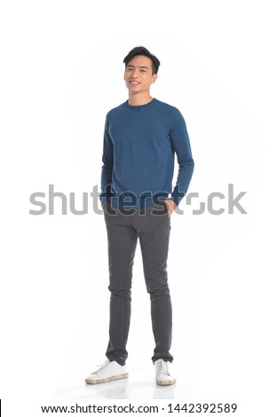 Full length portrait of asian young smiling man standing on white background    Stock photo ©