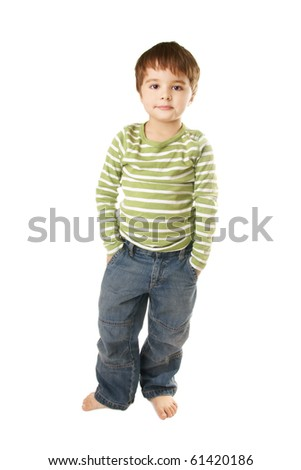 Full length portrait of asmiling little boy in jeans on white background