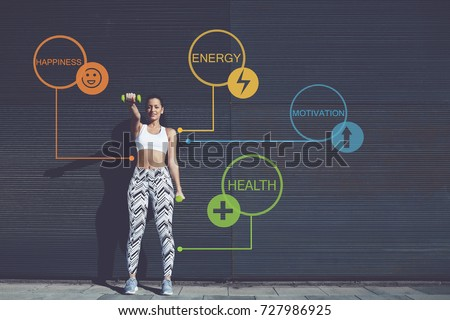 Full length portrait of athletic young woman lifting weights standing with arms tense against black wall outdoors, female working out training bicep. Infographics elements with sport health benefits - Shutterstock ID 727986925