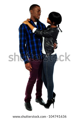 Full length portrait of attractive african couple hugging against white background