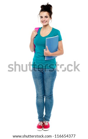 Full length portrait of attractive college girl holding notebook and backpack