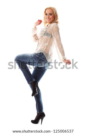 Full length portrait of beautiful casual woman with blonde hair posing over white background